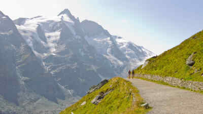 Hikers on a path in front of the Grossglockner