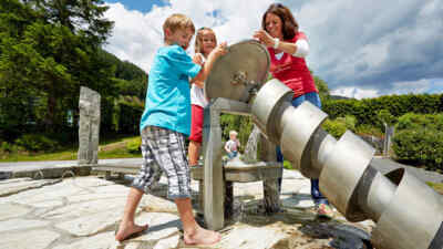 Family at the hydropower screw