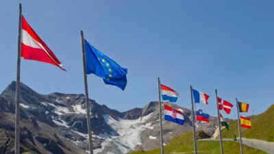Flags wave in the wind in front of the Grossglockner