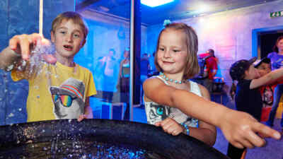 Two children test the exhibits